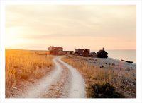 Fiskeby vid havet på Gotland i solnedgång